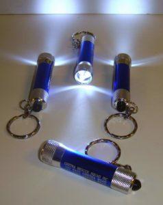 Super Bright Misprint Metal Push Button Flashlight Keychain